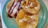 Pancakes with apple, sugar and honey